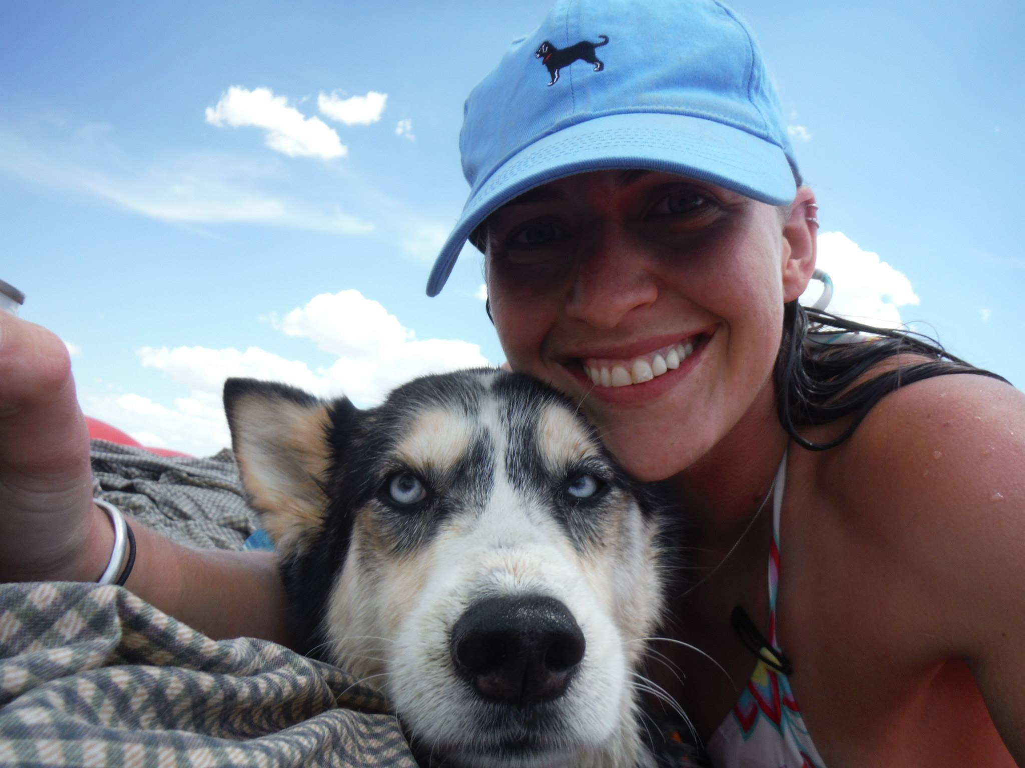 Photo of Jennifer Webster at the beach with her husky