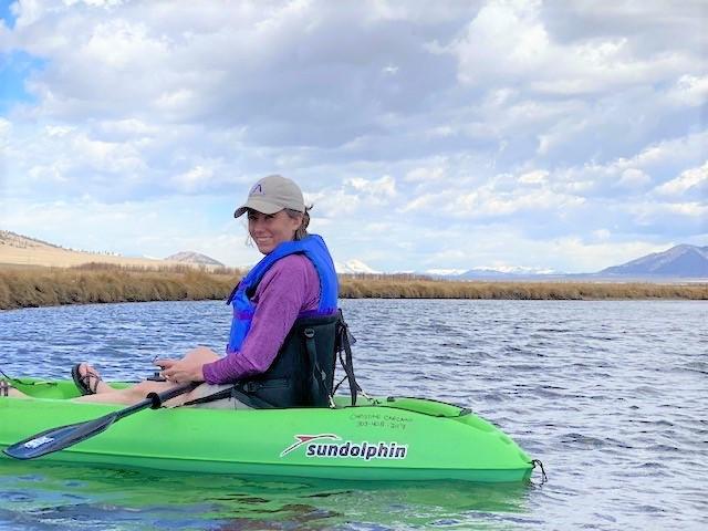Photo of Meg Druyor kayaking on a mountain lake